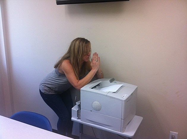 Judi Praying at the Printer