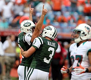 Nick Folk and Robert Malone celebrate the game winning kick
