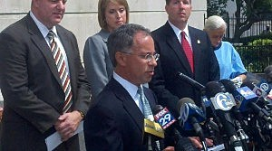 U.S. Attorney Paul J. Fishman reviews the charges against Trenton Tony Mack and six others.