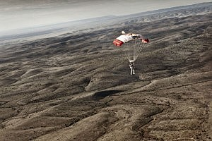 Pilot Felix Baumgartner of Austria descends to the desert after successfully completing the second manned test flight for Red Bull Stratos