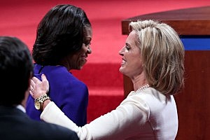 First Lade Michelle Obama (L) and Ann Romney embrace before the debate.