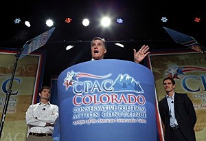 Mitt Romney speaks as his sons Matt Romney (L) and Josh Romney look on during the regional Conservative Political Action Conference