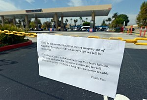 "A sign at a gas station at Costco Wholesale Corp. reads in part, ""We currently do not know when we will be resupplied,"" apologizing to customers after the gas station ran out of gas and closed in the Northridge section of Los Angeles"