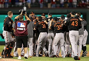 The Baltimore Orioles celebrate after they won 5-1 against the Texas Rangers during the American League Wild Card playoff game