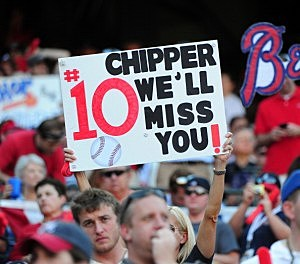A fan of Chipper Jones #10 of the Atlanta Braves holds up a sign of support during the game against the St. Louis Cardinals during the National League Wild Card Game at Turner Field