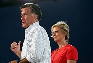 Mitt Romney (L) speaks next to his wife Ann Romney during a campaign rally in Apopka, Florida