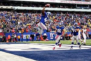 Ahmad Bradshaw celebrates his touchdown against the Cleveland Browns