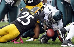 Ryan Clark #25 of the Pittsburgh Steelers causes Michael Vick #7 to fumble