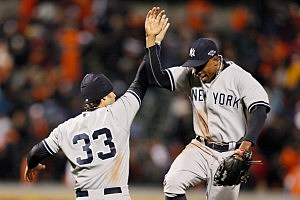 Nick Swisher #33 of the New York Yankees and teammate Curtis Granderson #14 celebrate after the Yankees defeated the Baltimore Orioles 7-2