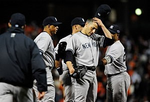 Andy Pettitte reacts before being pulled from the game in the eighth inning
