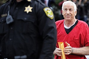 Jerry Sandusky walks into the Centre County Courthouse before being sentenced