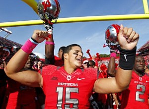 Quarterback Gary Nova #15 of the Rutgers Scarlet Knights celebrates their 23-15 win over the Syracuse Orange