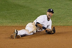 Derek Jeter of the New York Yankees reacts after he injured his leg in the top of the 12th inning against the Detroit Tigers during Game One of the American League Championship Series