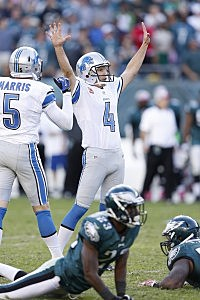 Jason Hanson #4 of the Detroit Lions celebrates after kicking a 45-yard field goal in overtime against the Philadelphia Eagles