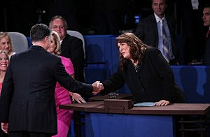 Mitt Romney shakes hands with moderator Candy Crowley