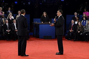 Republican presidential candidate Mitt Romney (R) speaks as President Barack Obama (L) and moderator Candy Crowley (C) listen