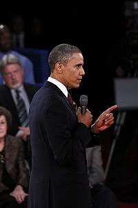 President Barack Obama gestures during a town hall style debate at Hofstra University