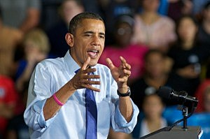 President Barrack Obama addresses a group at Cornell College in Iowa.