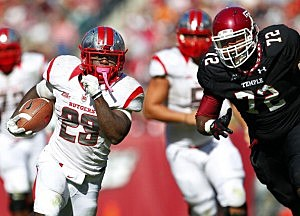 Jawan Jamison #23 of the Rutgers Scarlet Knights out runs Hershey Walton #72 of the Temple Owls
