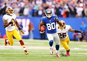 Victor Cruz runs the ball in for a 4th quarter touchdown against Washington.
