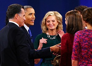 President Barack Obama (2L) greets the family of Republican presidential candidate Mitt Romney (L) with wife, Ann Romney (3L)