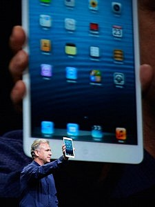 Apple Senior Vice President of Worldwide product marketing Phil Schiller announces the new iPad Mini during an Apple special event at the historic California Theater