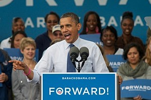 President Barack Obama addresses his supporters at the Quad at the Mississippi Valley Fairground