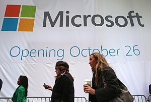 Pedestrians pass the soon-to-be-unveiled Microsoft store in Times Square