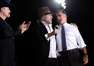 itt Romney (R) sings with musicians Big Kenny (C) and John Rich (L) during a campaign rally at Defiance High School  in Defiance, Ohio.