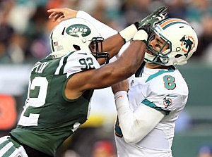 Marcus Dowtin collides with  Matt Moore #8 of the Miami Dolphins