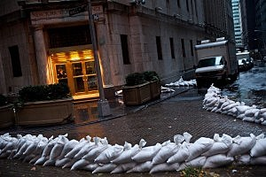 The closed New York Stock Exchange is barricaded with sand bags