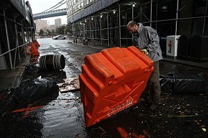 Portable, upended flood dikes are viewed on a flooded street in the Dumbo section of Brooklyn