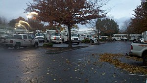 Utility trucks ready to go at a parking lot in Clinton.
