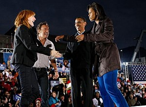 Barack Obama and wife Michelle meet with Bruce Springsteen and wife Patti Scialfa at a 2008 Obama campaign rally.