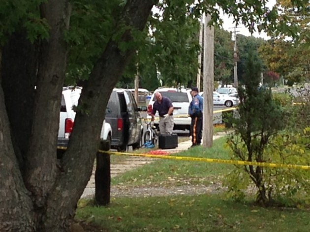 Authorities remove a white bicycle from the home where a recycling bin with Autumn Pasquale's body was found.