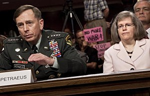 U.S. Gen. David Petraeus, the commander of U.S. forces in the Middle East, speaks during his confirmation hearing before the Senate Armed Services Committee as his wife Holly Petraeus listens