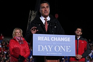 Mitt Romney speaks as his running mate Rep. Paul Ryan (R-WI) (R) and wife Ann Romney (L) look on during a campaign rally at The Square at Union Centre in West Chester, Ohio