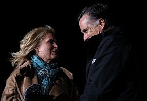 Mitt Romney (R) and his wife Ann Romney appear on stage together during a campaign rally at the Shady Brook Farm
