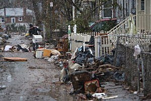 Eddie Saman clears out destroyed household belongings from his flood-damaged Staten Island home