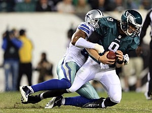 Nick Foles #9 of the Philadelphia Eagles is sacked by Victor Butler #57 of the Dallas Cowboys