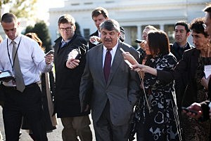 AFL-CIO President Richard Trumka (C) is surrounded by members of the media as he leaves the White House after a meeting with President Barack Obama