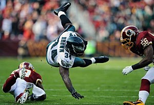 Running back Bryce Brown #34 of the Philadelphia Eagles is upended by Washington Redskins defenders