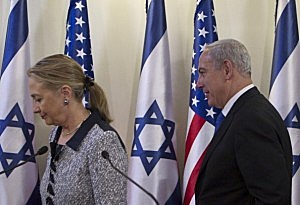 Israel's Prime Minister Benjamin Netanyahu (R) and U.S. Secretary of State Hillary Clinton leave after delivering joint statements