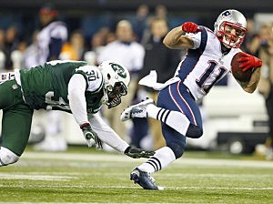 Wide receiver Julian Edelman #11 of the New England Patriots eludes LaRon Landry #30 of the New York Jets