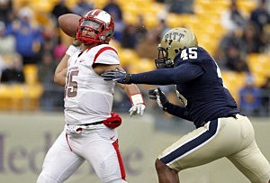 Gary Nova #15 of the Rutgers Scarlet Knights is pressured by Shayne Hale #45 of the Pittsburgh Panthers