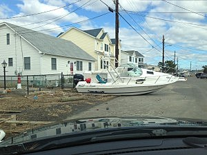 A boat on a side street in Beach Haven West