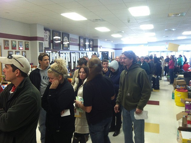 Seaside Park residents line up at Central Regional for passes to allow them access to visit their homes.