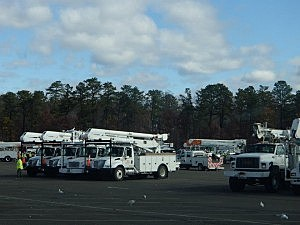 JCP+L utility trucks in a staging area in Ocean County