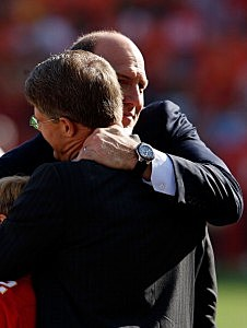 General Manager Scott Pioli of the Kansas City Chiefs hugs owner Clark Hunt
