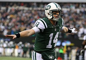Greg McElroy  celebrates throwing his first touchdown in the NFL